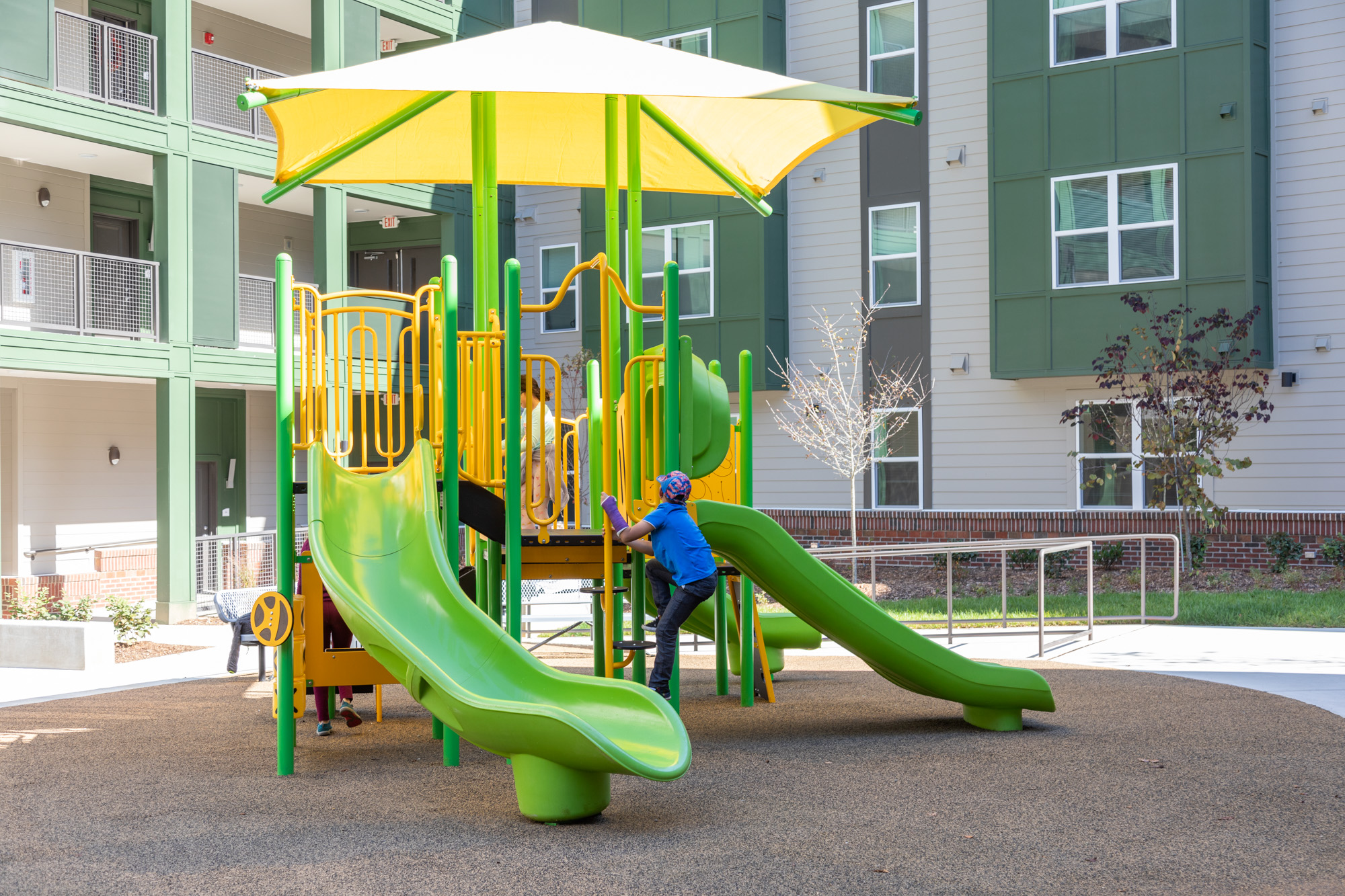 Children play on the East Haven playground.